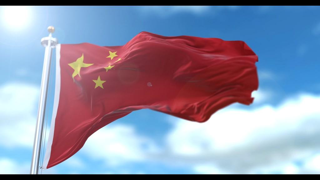 4k太阳蓝天白云流动五星红旗国旗飘扬图片